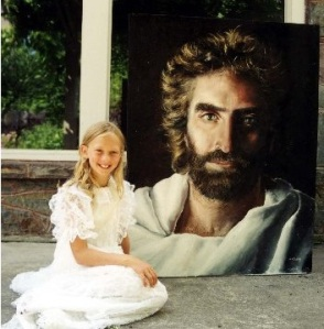Akiane, age 8, with her painting of Jesus